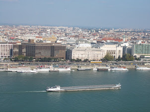 Shipping traffic on the Danube river in Budapest as viewed from Buda castle.