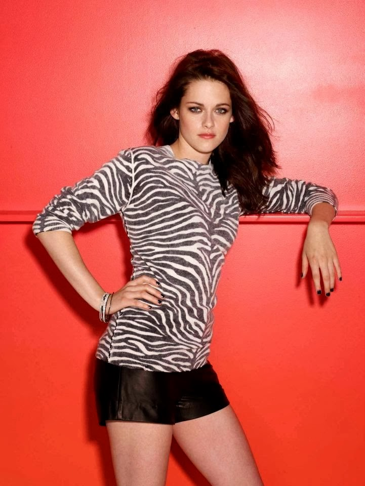 Animal skin colored shirt with black skirt