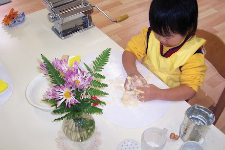 NAMC Montessori environment whole classroom of learning making dough