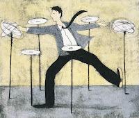 man spinning plates