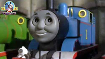 Thomas and his friends Gordon at the Island of Sodor roundhouse Thomas the train with a cheeky smile