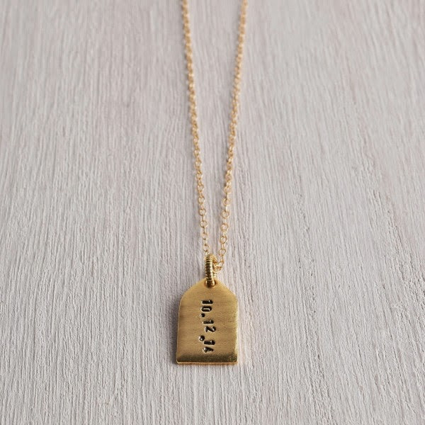 http://www.whitetrufflestudio.com/collections/new-arrivals/products/white-truffle-personalized-tag-necklace