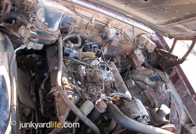 2-barrel carburetor sits atop the engine.