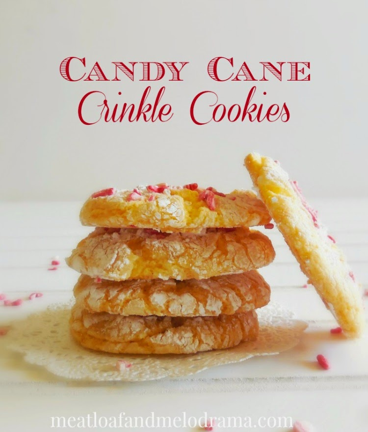 yellow crinkle cookies with powdered sugar and candy cane sprinkles made with cool whip and cake mix