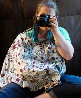 Practicing breastfeeding with a nursing cover