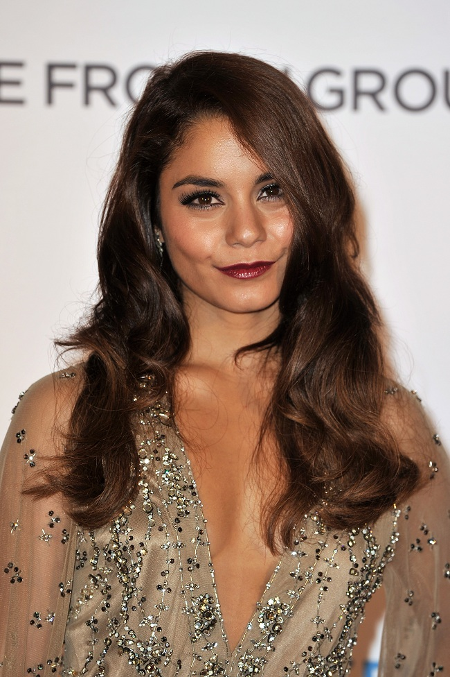 Vanessa Hudgens opted for a vampy lip colour, thick eyelashes, and soft wavy hair.