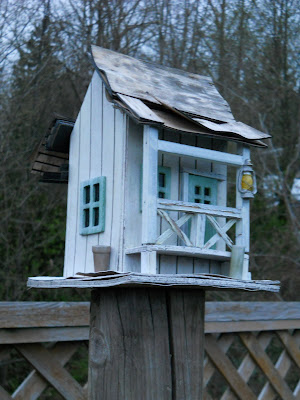Bird house with broken roof