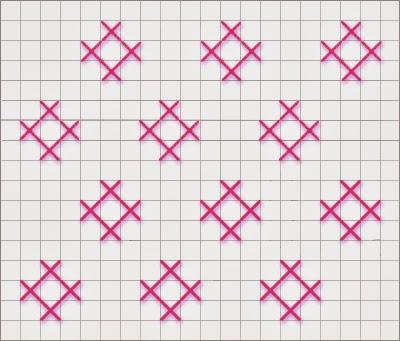 Coussin en noyaux de cerises tricoté main.