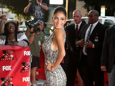 Nicole Scherzinger in form-hugging backless silver gown