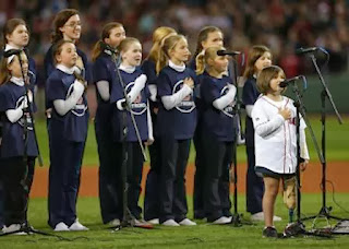The children of St. Ann's Parish in Dorchester sing the National Anthem before the game.(Credit: Getty Images)