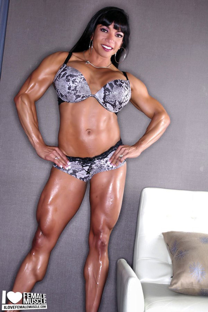 Marina Lopez Modeling Her Muscular Physique In Snake Skin