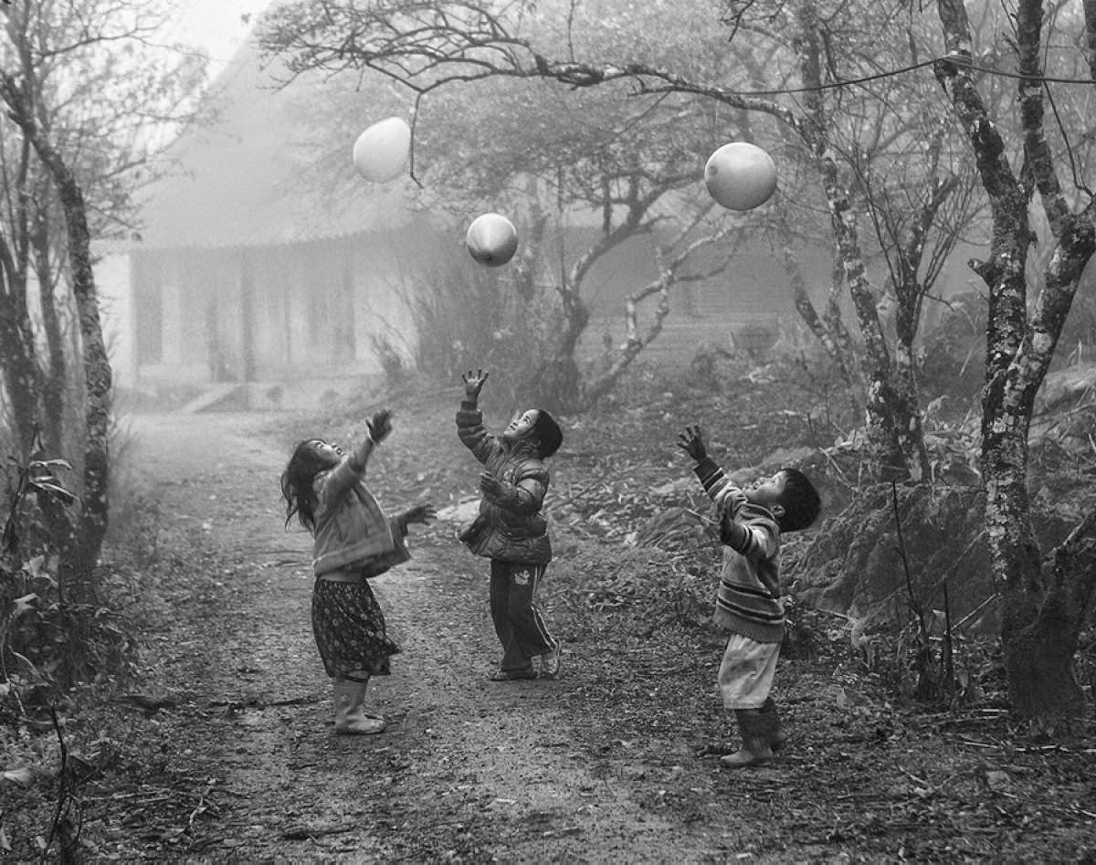 Children playing outside with balloons on a foggy day