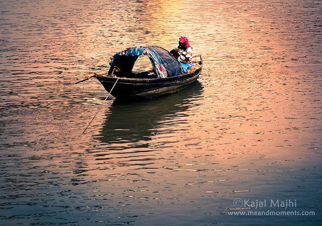 man on boat, boat on river ganga, fishing boat in ganga