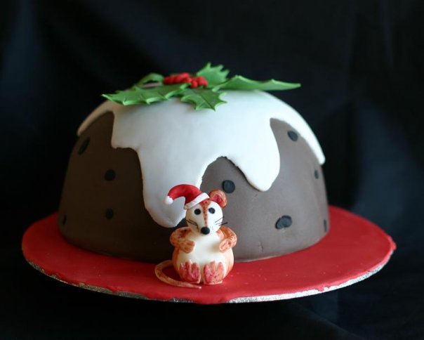Christmas pudding cake with a festive handcrafted mouse in front