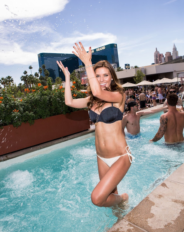 Audrina Patridge in the pool at Wet Republic wearing black and white bikini
