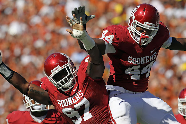 Jeremy Beal #44 and Jamarkus McFarland #97 of the Oklahoma Sooners celebrate a quarterback sack against the Texas Longhorns in the first quarter at the Cotton Bowl on October 2, 2010 in Dallas, Texas. (October 1, 2010 - Source: Ronald Martinez/Getty Images North America)