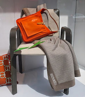 Hermès Fil d'Argent decorative pillow in terracotta, orange tote and blanket