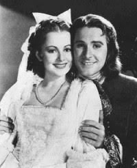 Olivia de Havilland and Errol Flynn