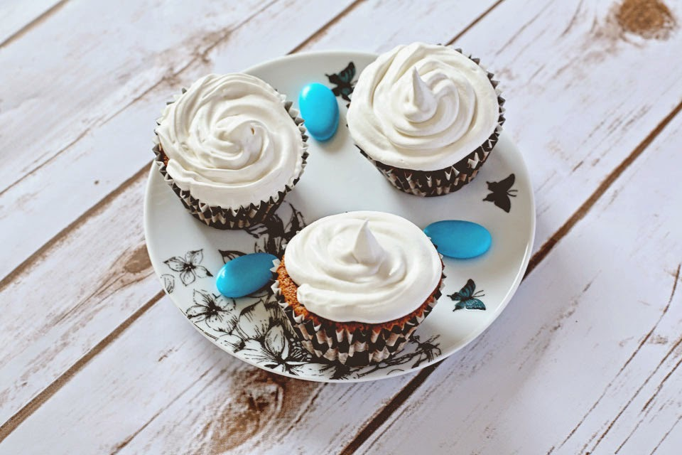 Three chocolate cupcakes with meringue icing on a pretty plate