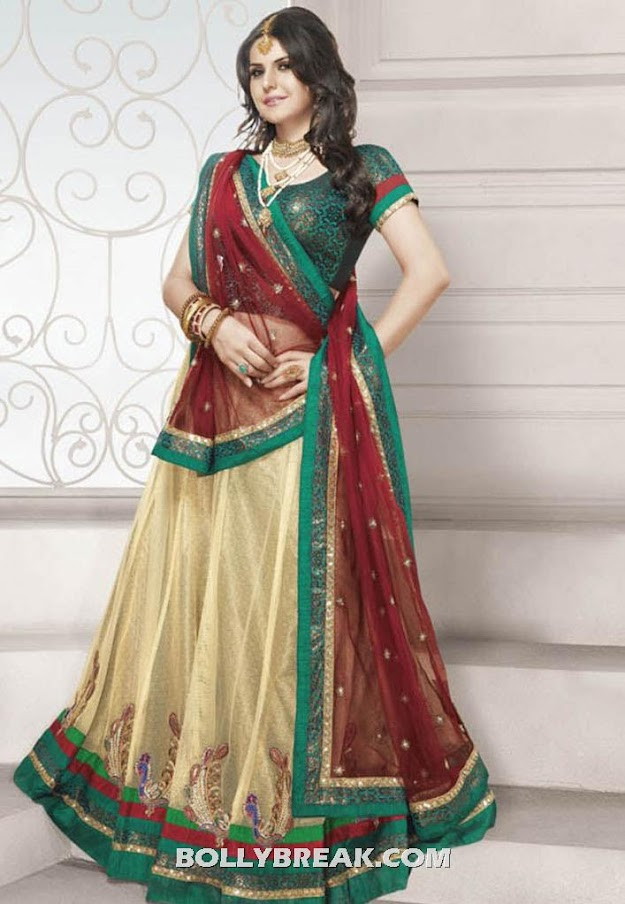 Zarine khan in a red, green and gold lehnga choli -  Zarine Khan in traditonal outfit