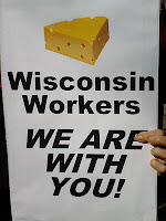 sign with image of cheese saying, Wisconsin workers, we are with you.