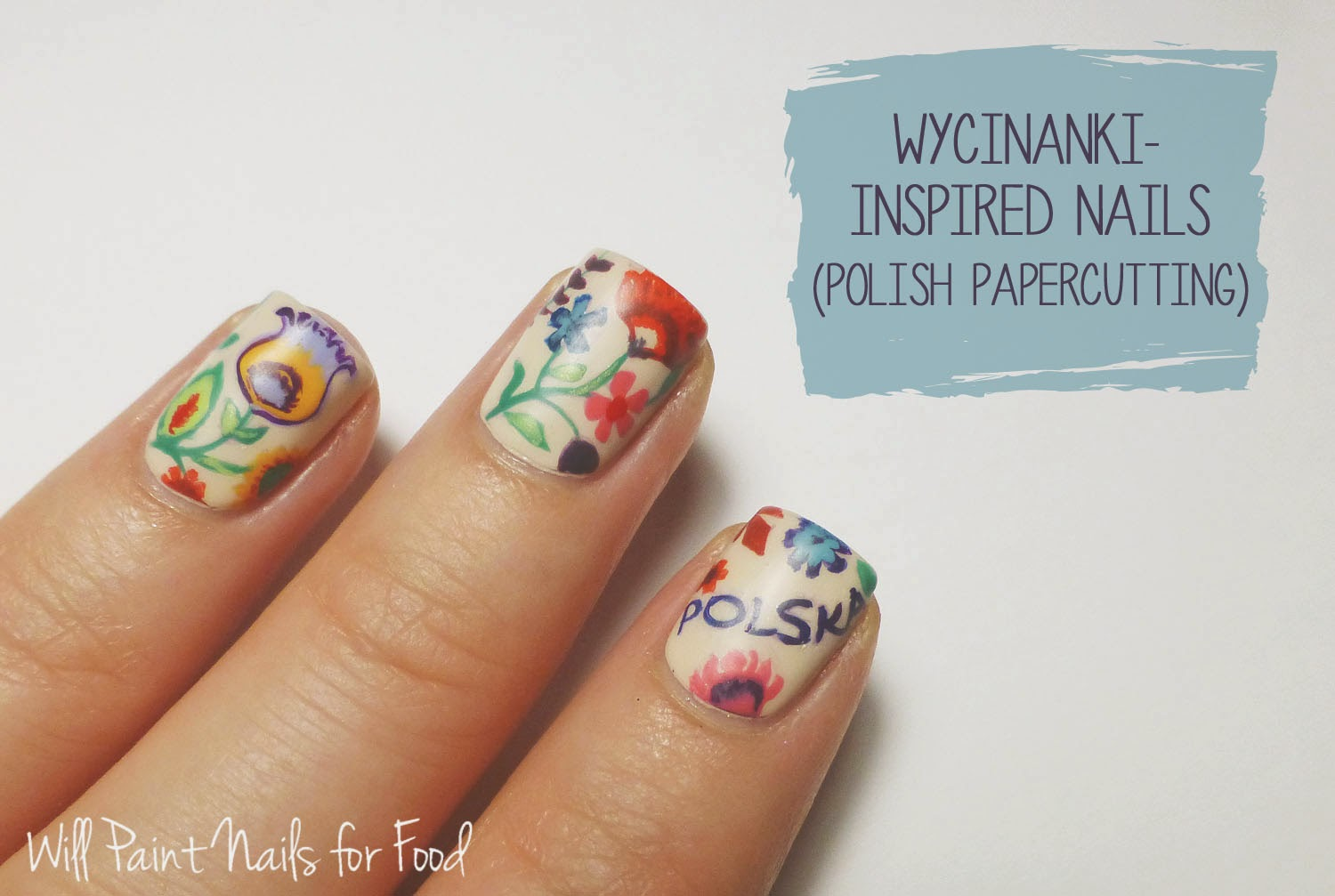 Wycinanki-inspired freehand nail art