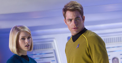 Captain Kirk in the company of beautiful doctor aboard the USS Enterprise. (Photo: Paramount Pictures)