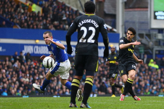 Wigan midfielder Jordi Gómez scores his side's third goal against Everton