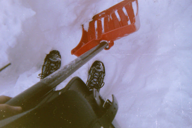 disposable camera, bad exposure, winter, Stuffeddoggie, snowfall, snow, nor'easter, shoveling, red shovel in the white snow, winter boots, self-portrait, black leather bag