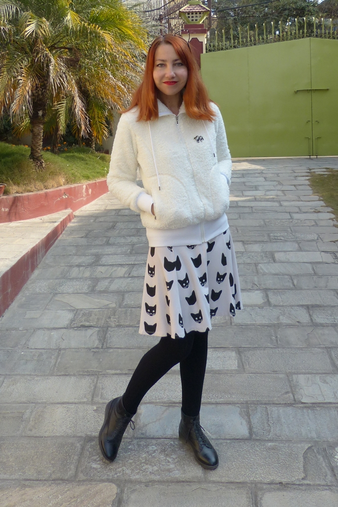 Outfit in black and white with kitty print skirt