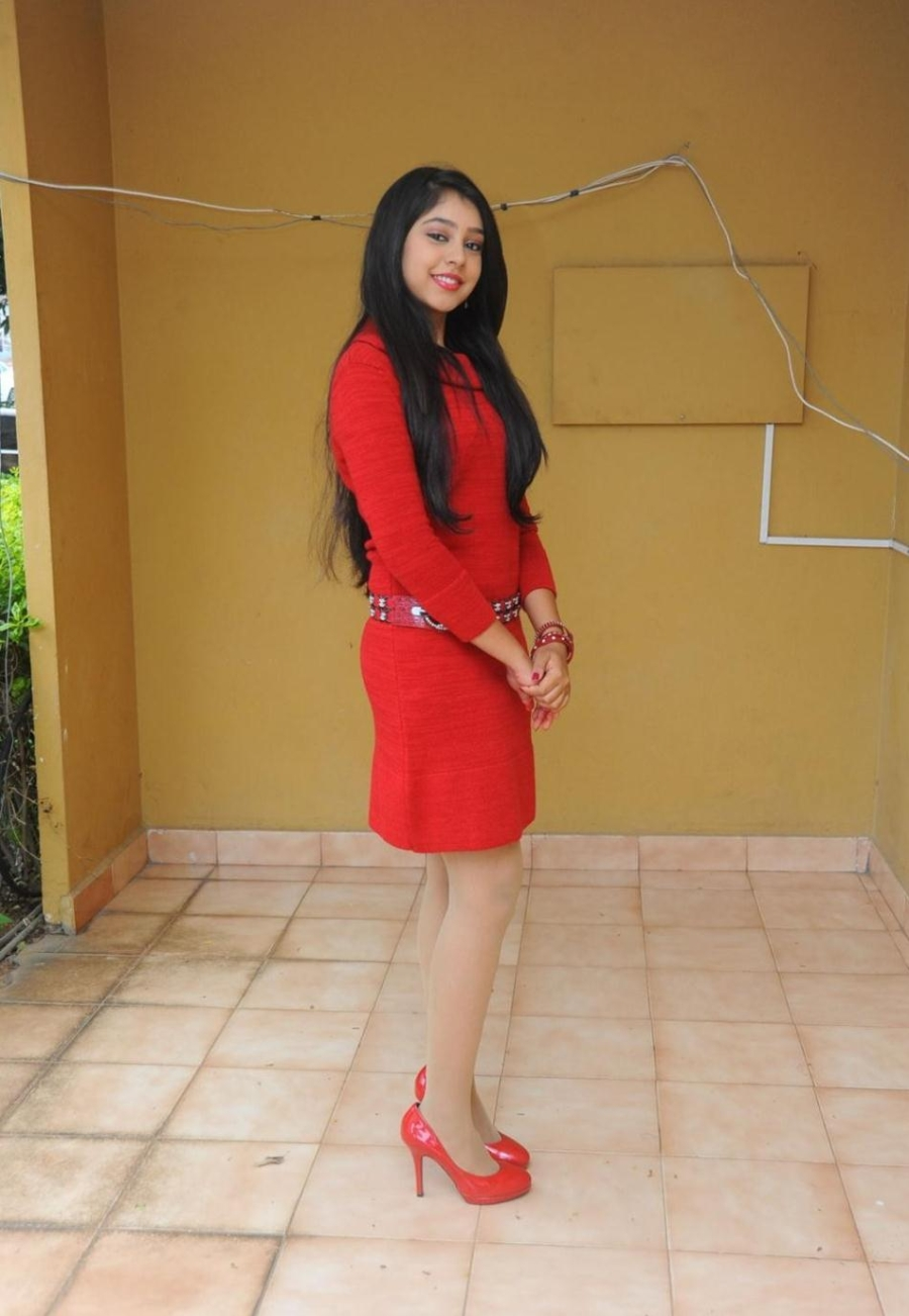 neethi taylor photo gallery in red dress at pelli pustakam