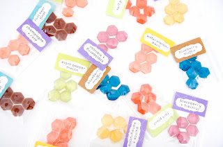 several flavors of hexagon-shaped hard candy gem pieces
