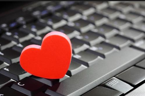 Lessons In On-Line Dating !!! - red heart on laptop computer
