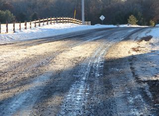 photo of snow melt on gravel road