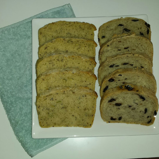 Homemade olive bread and white bread with seeds