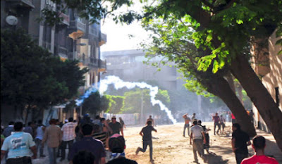 the violent clashes between the protesters and the Egyptian police