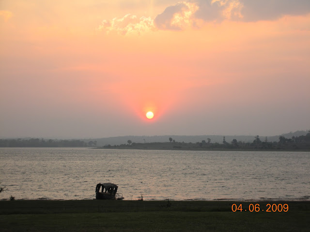 Sunset over Kabini river with boat