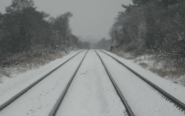 Converging railway lines in snow