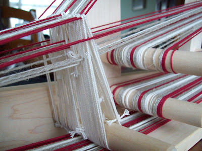Warp and heddles on an inkle loom