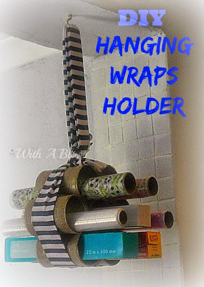 DIY Hanging Wraps Holder ~ Quick & Easy craft ! Use Empty cans to create this handy, hanging holder for all those rolls of wraps #Storage #Organizing #DIY