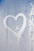 Heart drawn on a steamy window