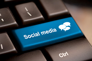 An illustration for Social Media using a bright blue social media button on a regular gray keyboard.
