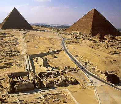 A view of the Giza Plateau with the Great Sphinx and its temples in the foreground