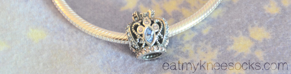 Soufeel's crown charm is sterling silver with a mix of white, red, and blue rhinestones.
