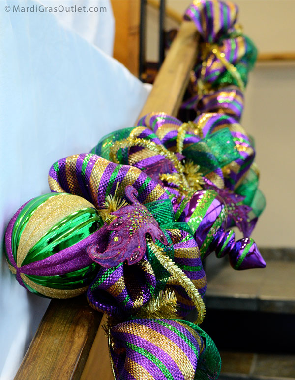 Additional Big Metallic Ornaments add more sparkle to this Mardi Gras Work Form Garland.