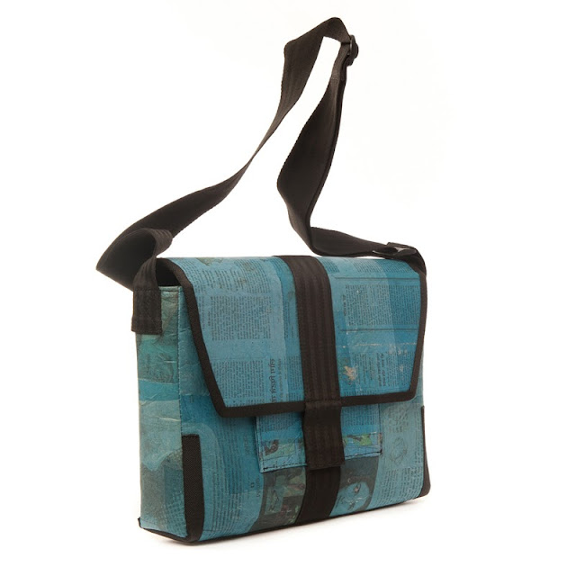 Shoulder bag made from recycled newsprint and seatbelts designed by Alkemi