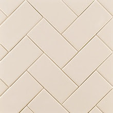 White subway tile herringbone pattern