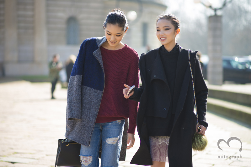 Model Chiharu Okunugi and Xiao Wen Ju leave Roberto Cavalli show during Milan Fashion Week MFW