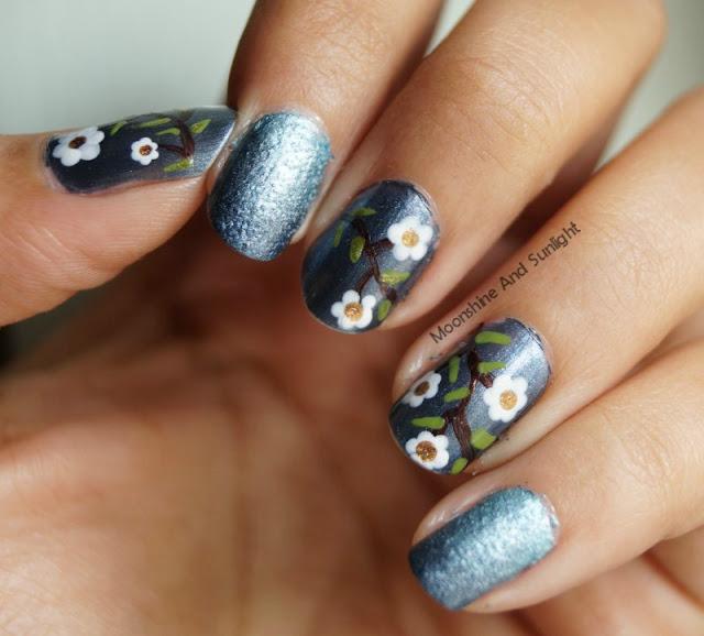 Floral nail art on metallic base