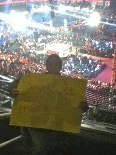 fan holding wrestling crowd sign monday night raw